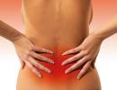 Болит низ спины, что делать?